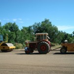 Equipment on top of soil during a 2010 intelligent compaction demo project in North Dakota