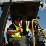 Two workers on equipment during an intelligent compaction demo project in North Dakota