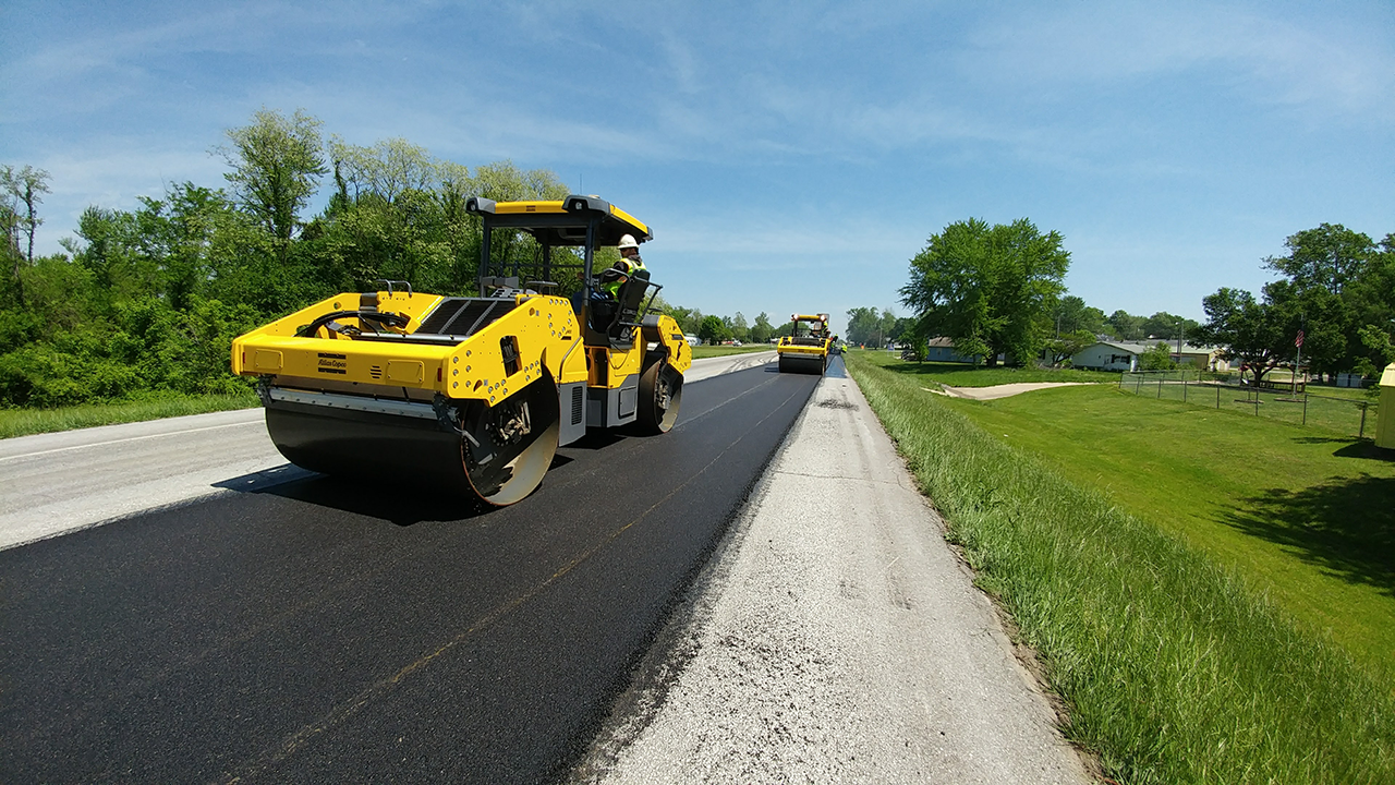 Workers operate IC rollers on Route 52 in Morgan County, Missouri
